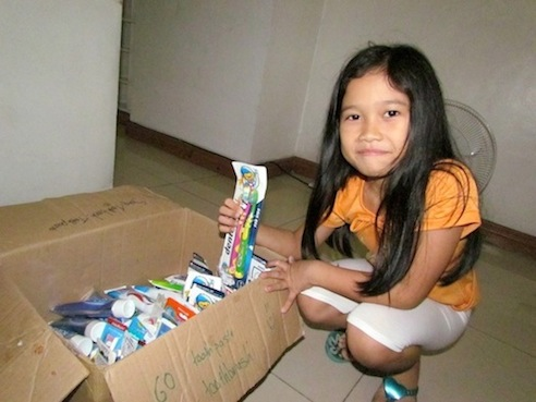 Shaina, my little assistant, who helped me count and record donated goods.